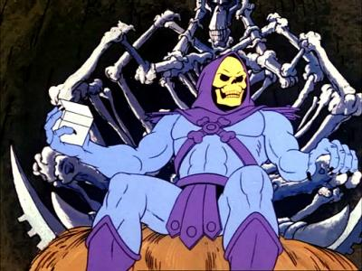 Skeletor holding the box of Diamond Ray of Disappearance.