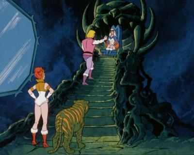 Prince Adam hands the Sorceress a box.