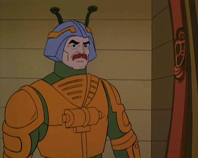 Man-At-Arms standing in front of a hanger.