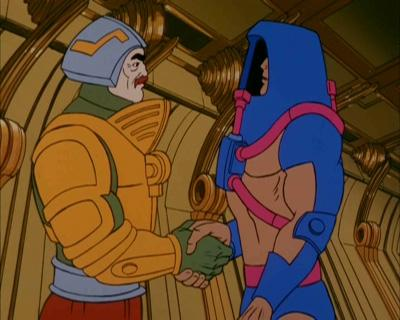 Man-E-Faces stands opposite Man-At-Arms.