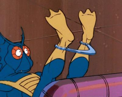 Mer-Man looks confusingly at his feet.