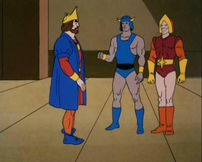 King Randor is addressed by two warriors.